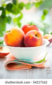 Bowl of fresh peaches on the table