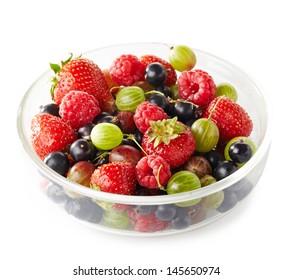 Bowl of fresh ripe berries on white background