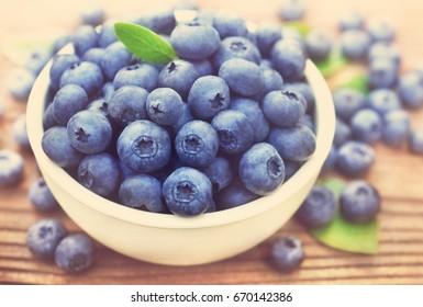 Bowl of fresh ripe sweet juicy blueberries, selective focus, toned