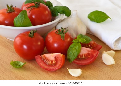 Bowl of fresh ripe tomatoes with garlic and basil
