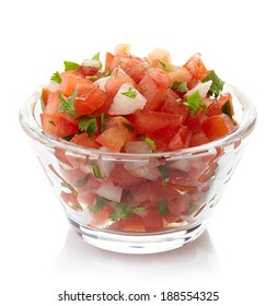 Bowl of fresh salsa dip isolated on white background