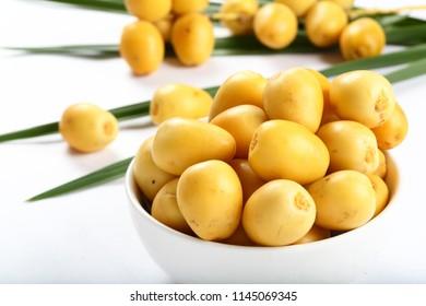 Bowl of Fresh sweet organic date fruits.