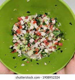 bowl of fresh traditional Mexican fish ceviche with tomato cilantro lime juice