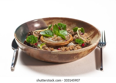 Bowl of fried minced meat with cranberry sauce