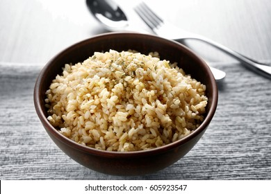 Bowl full of brown rice on napkin