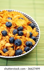 bowl full of corn flakes with fruits - diet and breakfast