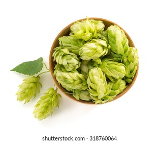 bowl full of hop cones isolated on white