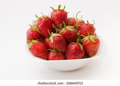 bowl full of ripe juicy strawberry on a white background