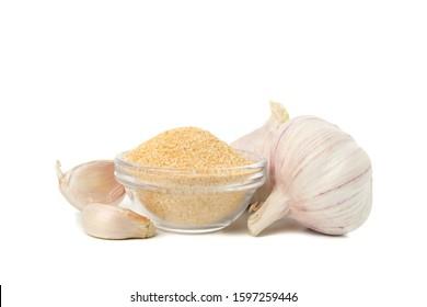 Bowl with garlic powder isolated on white background