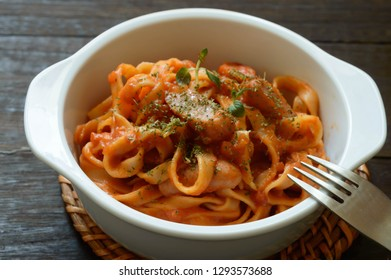 a bowl of gluten free fettuccine with arrabiata sauce