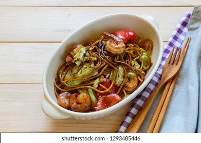 a bowl of gluten free yakisoba noodles with cabbage and shrimp