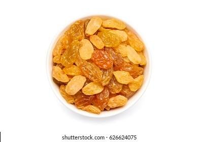 Bowl of golden raisins on white