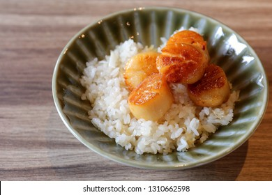 A bowl of grilled Hotate (or called Conpoy or dried scallo) Rice. The traditional Japanese food.