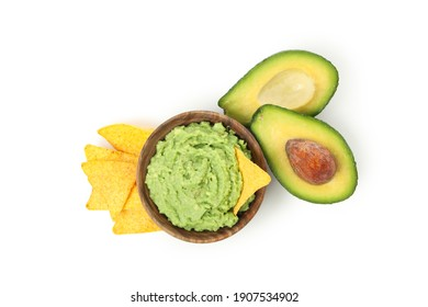 Bowl of guacamole, avocado and chips isolated on white background