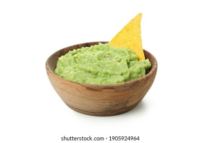 Bowl of guacamole with chip isolated on white background