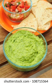 Bowl of guacamole made from fresh avocados, chips and salsa