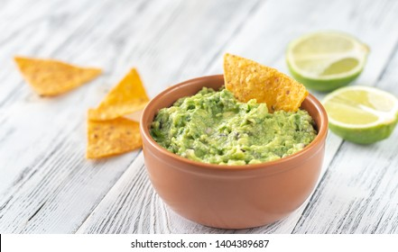 Bowl of guacamole with tortilla chips close-up