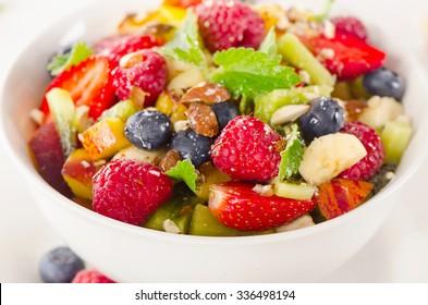 Bowl of healthy fresh fruit salad. Selective focus