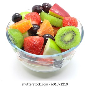 Bowl of healthy fresh fruit salad on white background. Top view.