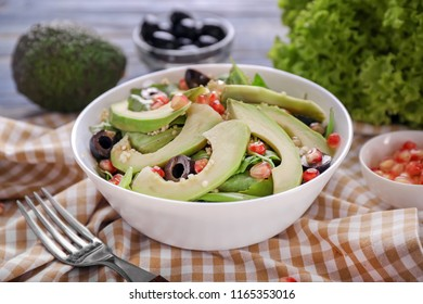 Bowl with healthy fresh salad on table