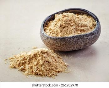 bowl of healthy maca powder