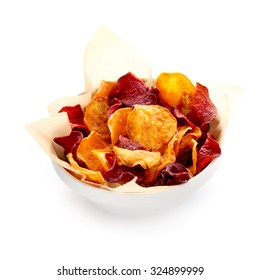 Bowl of healthy organic beetroot chips served with crisp golden potato chips for a tasty vegetarian finger food snack or appetizer , isolated on white