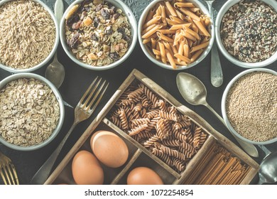Bowl with healthy whole grain carbohydrates and eggs, kamut, seeds, oats, brown rice, spaghetti. Healthy and organic food