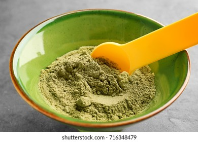 Bowl of hemp protein powder with spoon on table