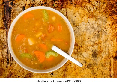 Bowl of Homemade Chunky Vegetable Soup On A Disteressed Oven or Baking Tray