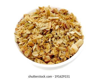 Bowl of homemade granola with pumpkin and sunflower seeds and almonds