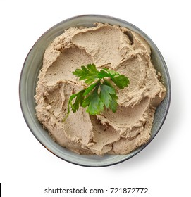 Bowl of homemade liver pate isolated on white background, top view