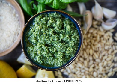 Bowl of homemade pesto and  fresh ingredients viewed from above