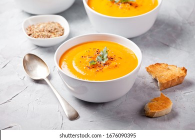 Bowl of homemade soup with organic pumpkin butternut squash and carrot