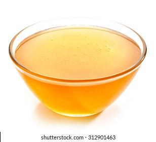 bowl of honey isolated on white background