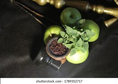 bowl of hookah tobacco. berries on a black background. nargile smoking