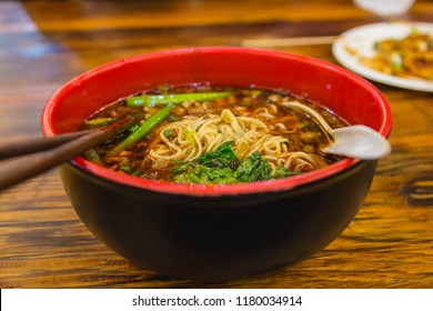Bowl of hot and spicy chinese noodle soup, spicy ramen.