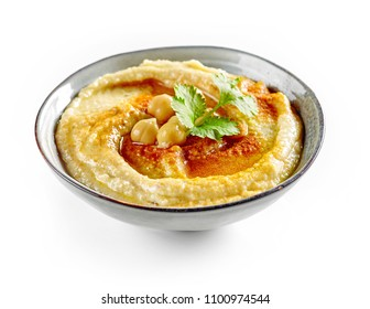bowl of hummus isolated on white background