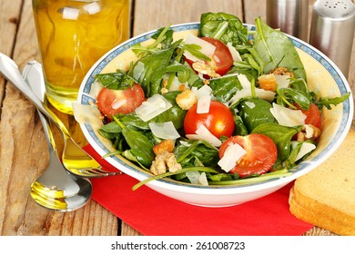 bowl of italian salad on wooden table
