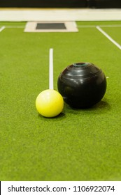 Bowl and jack on an indoor bowls carpet