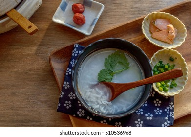 a bowl of Japanese rice porridge (okayu). Okayu is commonly served as winter dish in Japan.