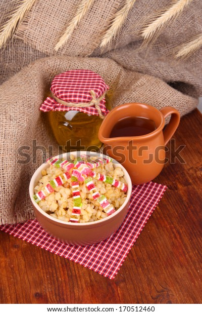 Bowl with kutia -  traditional Christmas sweet meal in Ukraine, Belarus and Poland, on wooden background