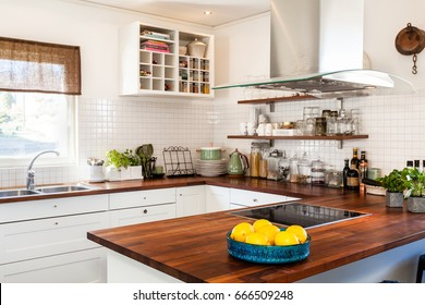 bowl with lemon at the wooden kitchen counter top