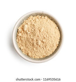 Bowl of maca powder isolated on white background, top view
