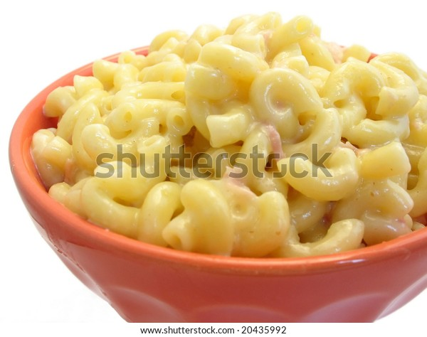 Bowl of macaroni and cheese on white, with ham and pepper