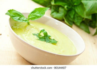 a bowl of marrow soup with basil leaf