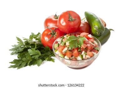 Bowl of Mexican salsa, jalapeno, tomatoes and parsley
