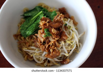 A bowl of mi or mie ayam (chicken noodle), a national Indonesian food.