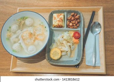 A bowl of milkfish porridge with fried bread sticks. Looks so delicious.