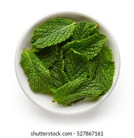 Bowl of mint leaves isolated on white background, top view