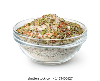 Bowl of mixed aromatic salt, spices and herbs isolated on white